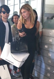 Hailey Baldwin ran errands in style carrying a black croc-embossed tote by Saint Laurent.
