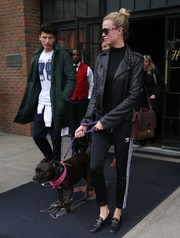 Hailey Clauson walked her dog in style wearing a black leather jacket over a turtleneck.