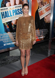 Carly Craig paired her golden dress with flattering nude leather platform peep toes.