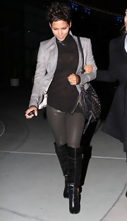 Halle Berry looked tough chic in over the knee leather boots. She paired the on-trend footwear with leather leggings and a sheer tee for a daring look.