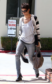 Halle Berry's zippered skinny jeans revealed black wedge ankle boots.