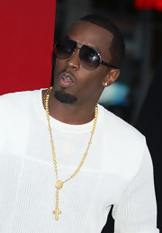 Sean Combs went to the premiere of 'The Hangover Part II' wearing a gold and diamond rosary necklace.
