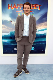 Elijah Wood arrived at the LA premiere of 'Happy Feet Two' wearing a classic gray suit.