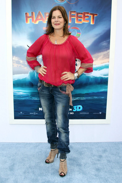 Marcia Gay Harden arrived at the premiere of 'Happy Feet Two' showing of her toes in nude ruffled cutout ankle boots.