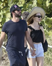 Heather Graham was spotted out at the beach wearing a wide-brimmed straw hat.