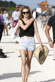 Heather Graham took a stroll at the beach wearing faded denim shorts and a black top.