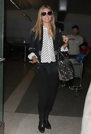 Heidi Klum paired an embroidered blazer over her patterned blouse for a cool mix of prints.