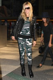 Heidi Klum was spotted at LAX looking edgy in camouflage pants, a matching top, and a leather moto jacket.
