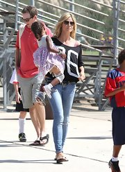 Heidi Klum kept casual for son Henry's flag football game in flip flops.