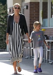 To add an unexpected masculine touch to her maxi dress, Heidi Klum opted for a classic black leather jacket.