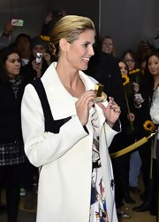 Heidi Klum wore her shiny tresses in a sleek, classic bun while promoting her fragrance in NYC.