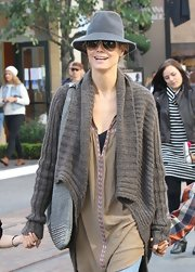 Heidi Klum went incognito amongst LA shoppers wearing a structured fedora and sleek aviators.