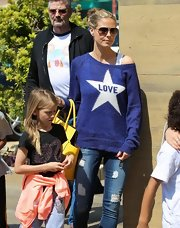 Heidi Klum chose this off-the-shoulder sweater for her fun and flirty look while out with her kids.