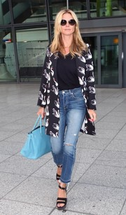 Heidi Klum completed her airport look with studded black platform sandals by NewbarK.