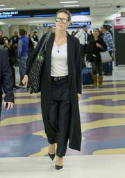 Underneath her coat, Heidi Klum wore black slacks and a white V-neck tee.