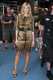 Heidi Klum put her best foot forward outside 'Good Morning America' in a silky leopard print dress teamed with black patent T-strap sandals. Gold trim gives the Daisy heels subtle, yet sexy shine.