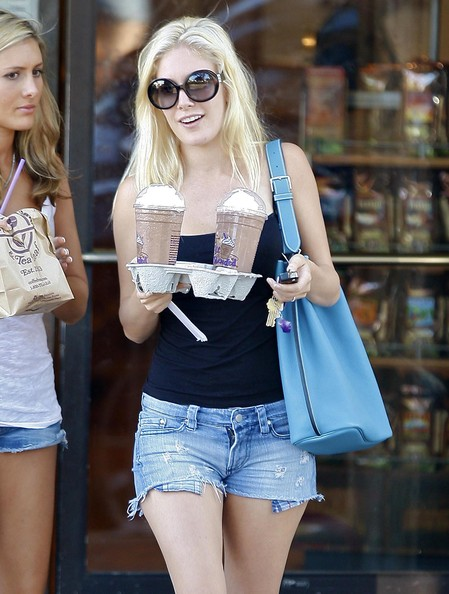 Reality star Heidi Montag is seen leaving a coffee shop with a friend looking surprisingly casual. She added a cute blue shoulder bag for added interest.
