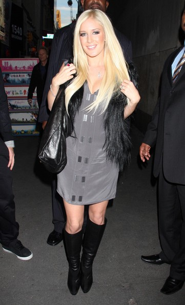 """Heidi wore a dark gray, v-necked """"Rivet Shift Dress""""with a pair of knee-high leather boots and a fur vest."""