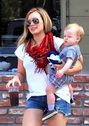Hilary Duff chose a red, Western-style, fringe scarf for her casual look while out with her family.