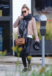 Hilary Duff was spotted outside her gym wearing stylish black and silver leggings by Nike.
