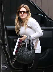 Hilary Duff hit the gym in a pair of oversize cateye sunglasses with orange lenses.