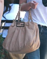 Hilary Duff paired her casual ensemble with a tan leather shoulder bag. The chain straps were the perfect finish to the classic bag.