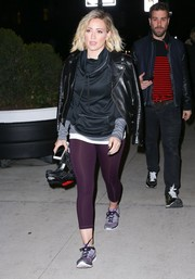 Hilary Duff headed to her hotel looking sporty in purple C9 by Champion leggings teamed with a black sweatshirt.