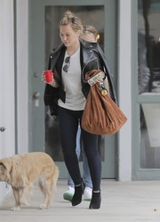 Hilary Duff was edgy in black booties, skinny jeans, and a leather jacket while out shopping in Brentwood.