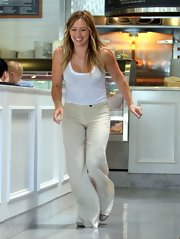 Hilary Duff chose a classic white tank to pair with wide leg pants for an airy and summery daytime look while out grabbing lunch.