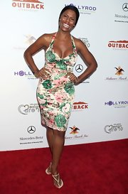 Omarosa paired her white sandals with a floral print dress.