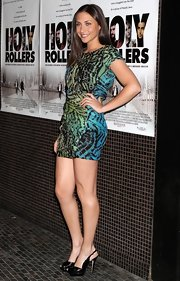 Stella stood out in a vibrant, printed mini dress with a pair of peep-toed, patent leather, slingback pumps.