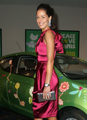 Ana Ivanovic's wine-colored dress and metallic silver clutch were a totally elegant pairing.