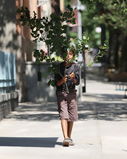 Oscar Jackman wore a pair of loose brown cargo pants as he pretended to hide behind a branch while walking around New York City.