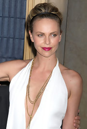 Charlize Theron wore her hair in soft curls with a cute headband at IFP's 21st Annual Gotham Independent Film Awards.