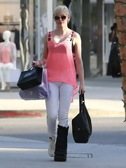 Rose McGowan chose a sheer sleeveless blouse for her casual look while out shopping in Beverly Hills.