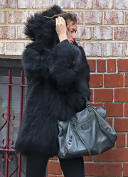 Irina Shayk braved the windy streets of New York City toting a chic leather City bag.