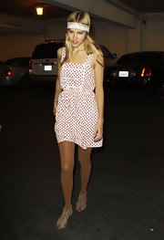 Isabel completed her polka-dotted dress with lace-up leather sandals.