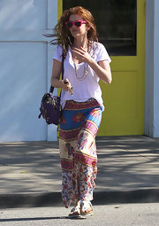 Isla Fisher left the hair salon in this print maxi-dress.