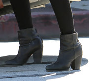 Simple, stylish black ankle booties finished off Isla Fisher's cozy sweater and leggings combo.