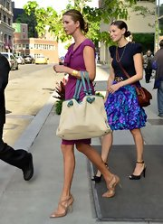 Ivanka Trump stepped out in NYC wearing a lovely raspberry-hued dress paired with tan leather heels.