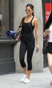 Jamie Chung headed to yoga class wearing a tight black tank top.