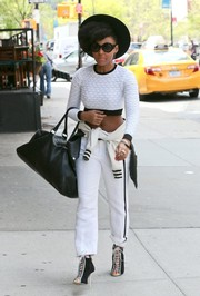 Janelle Monae continued the athletic vibe with a pair of white side-stripe pants.