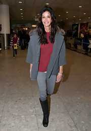 A low-key Janice Dickinson hit the airport in a thick gray knit sweater with a fur-trimmed collar.