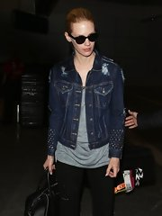 January Jones opted for this distressed denim jacket with studded sleeves while flying to LA.