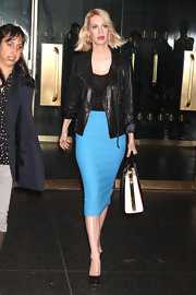 January Jones brightened her black pieces with a bold turquoise pencil skirt and red lips.