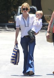 January Jones kept her look simple and chic while out with her son when she wore this white button down with blue trim.