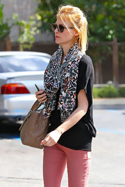 January Jones looked cozy in her black top and butterfly scarf while out in Pasadena.