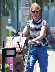 January Jones went for playful styling with a pair of orange shades.