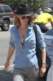 January Jones topped her weekend wardrobe with a black straw fedora.