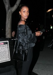 Jasmine Tookes accessorized with a black Givenchy mini Antigona while dining out at Mastro's Steakhouse.